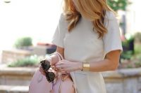 12 modest neutral-colored dress and a statement bracelet