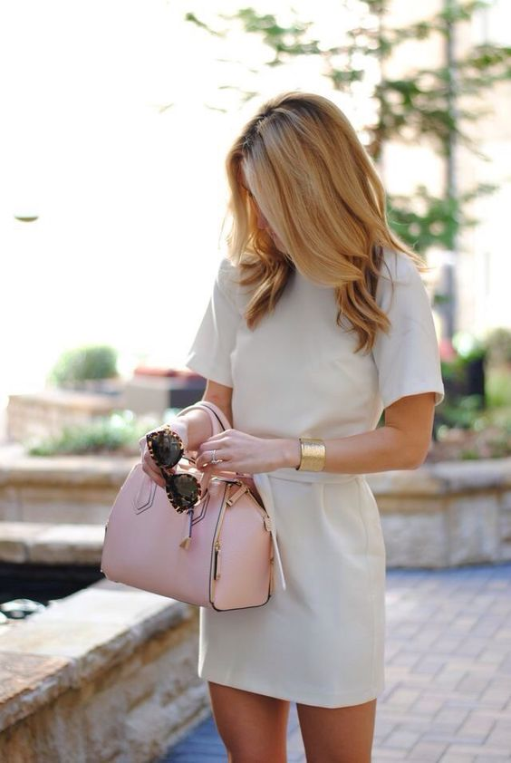 modest neutral-colored dress and a statement bracelet