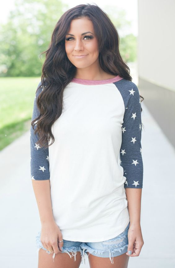 star sweatshirt and denim shorts