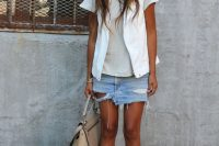 13 distressed denim mini with a neutral top and a white blazer