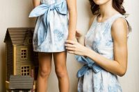 13 matching serenity colored blue floral dresses