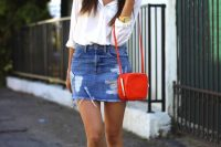 14 distressed denim mini, a white shirt and sneakers