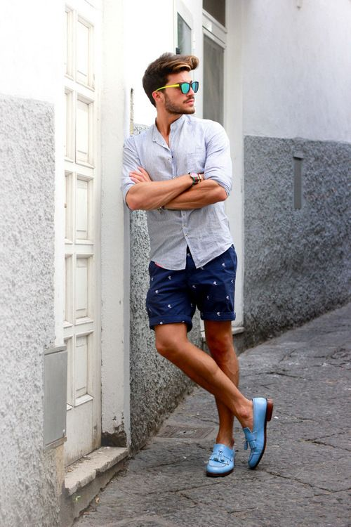 printed navy shorts and light blue shoes