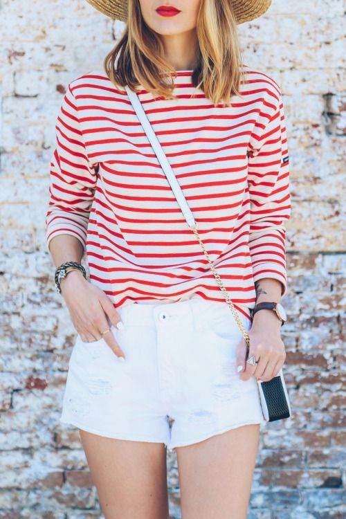 white shorts and a red and white striped shirt
