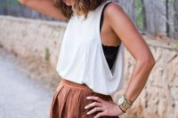 15 black lace top, a white top on it and a brown faux leather skirt