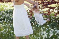 15 matching white spaghetti strap dresses