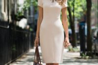 15 white knee-length dress with a statement necklace