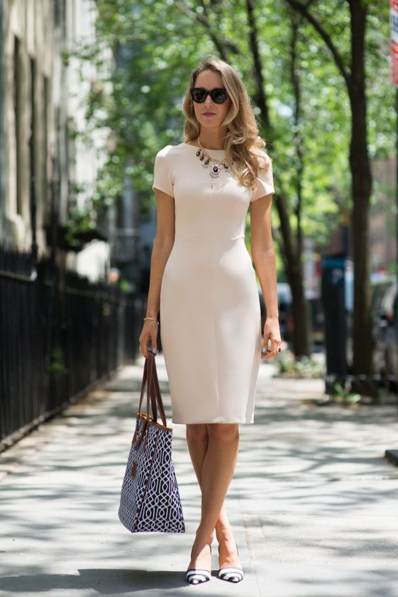 white knee-length dress with a statement necklace