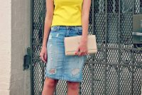 16 distressed denim skirt with a yellow top and lace up sandals