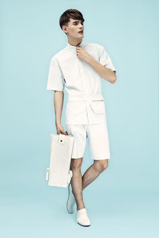 white high-waist shorts and a white shirt