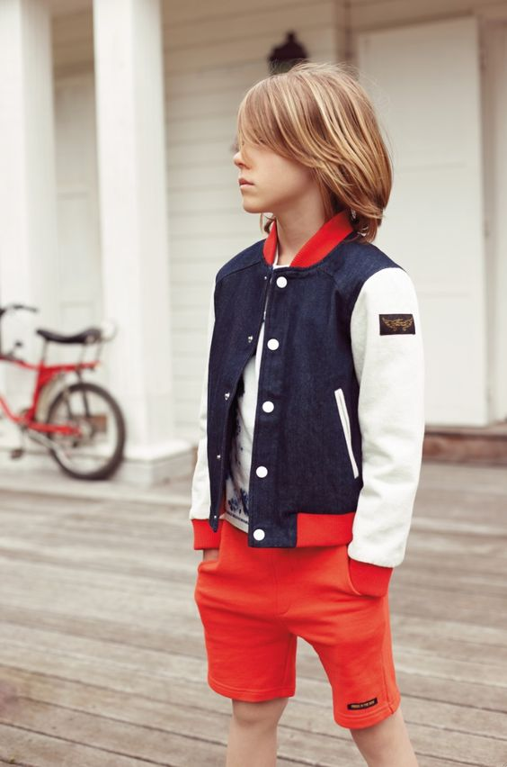 red shorts, a white tee and a long sleeved jacket for a coastal look