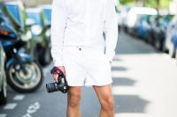 17 white shorts and a long-sleeved shirt with white shoes