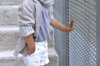 18 white printed shorts, a blue tee, grey sneakers and a grey shirt