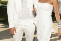 19 a white suit and a white top by Ashton Kutcher