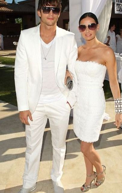 a white suit and a white top by Ashton Kutcher