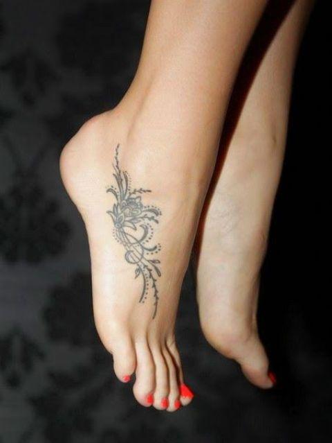 flower pattern foot tattoo