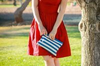 19 sweetheart red dress with a stiped clutch
