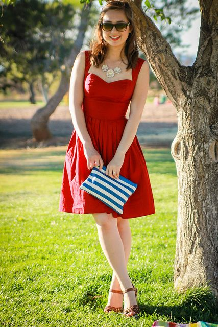 sweetheart red dress with a stiped clutch