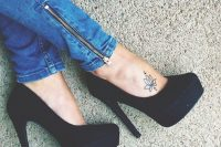 20 flower tattoo on a foot
