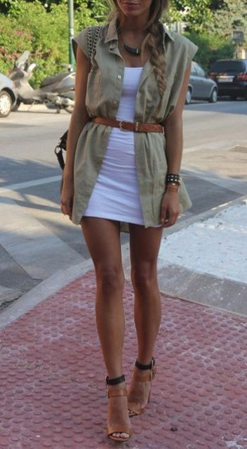 white bodycon dress and a neutral vest with a belt