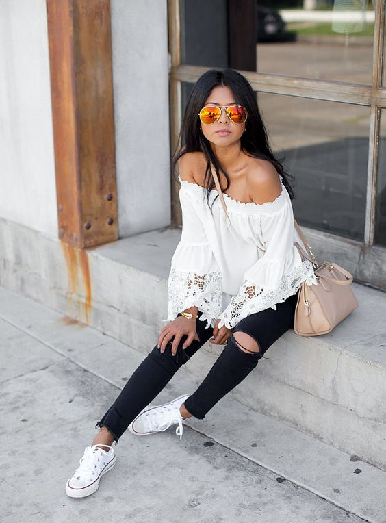 distressed jeans, an off the shoulder blouse and white converse