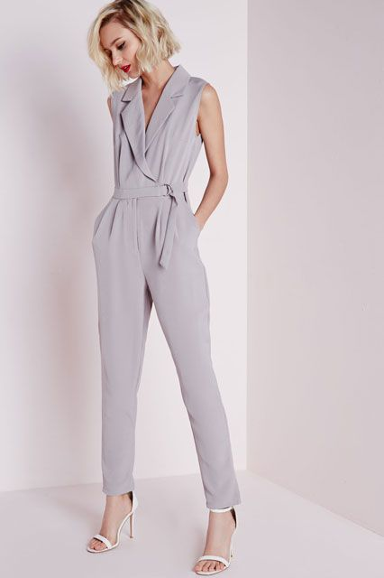 grey jumpsuit and white heels