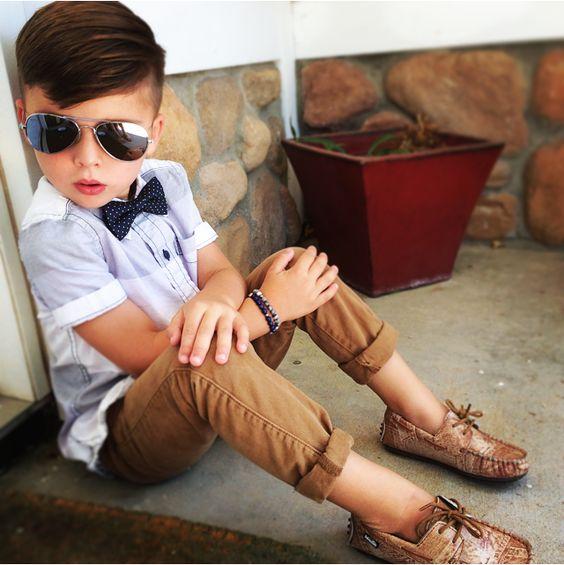 tan pants, a short-sleeved shirt and toms