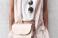 22 blush trousers, a white top and a blush vest for a cool summer day