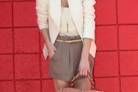 22 grey shorts, a white top and a white jacket