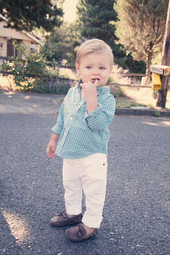white pants, a checked shirt and toms