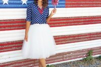 22 white tulle skirt with a polka dot navy shirt