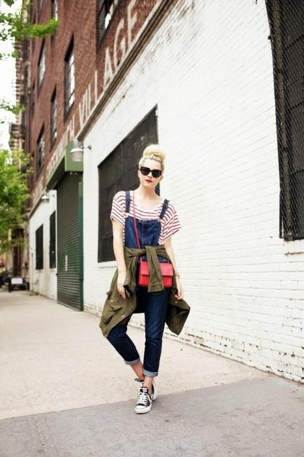 denim dungaree with a striped tee and bold red crossbody