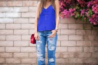 24 disressed jeans, blue top and red shoes
