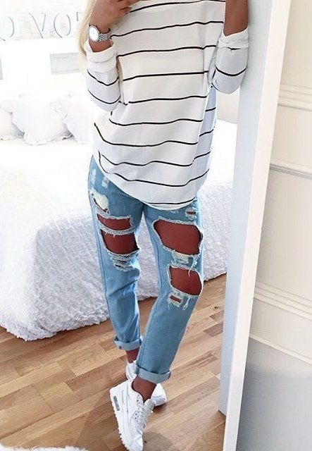 ruined jeans, a striped shirt and white converse