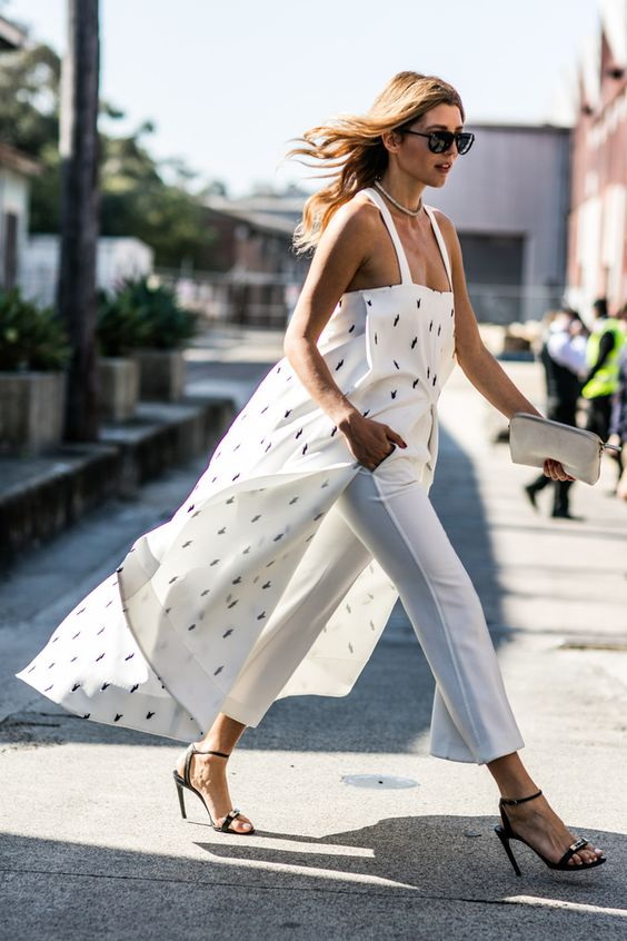 white trousers and a long tunic