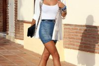 25 denim mini with a white top and vest