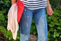 25 jeans and a stiped tee with a red clutch