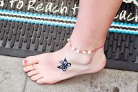 25 small butterfly tattoo on a foot
