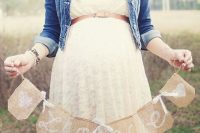 26 white lace dress with a thin belt and a denim jacket for a baby shower