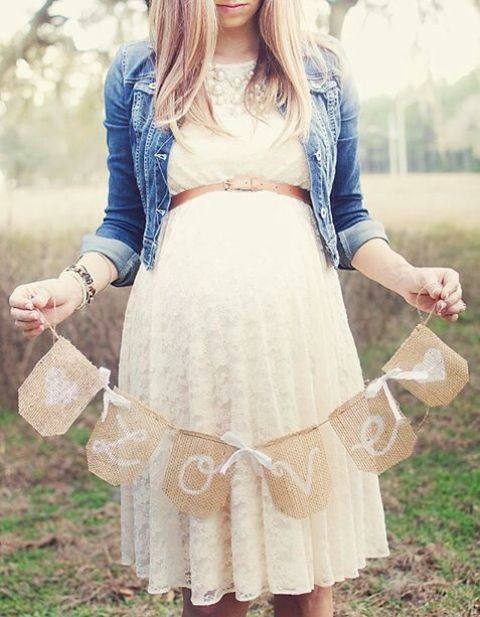 white lace dress with a thin belt and a denim jacket for a baby shower