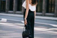 Black and white look with ruffle top and trousers