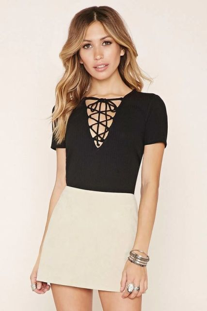 Black lace up shirt with white skirt