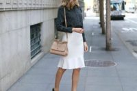 Black shirt with trumpet skirt