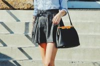 Casual look with black skater skirt, denim shirt and colorful shoes