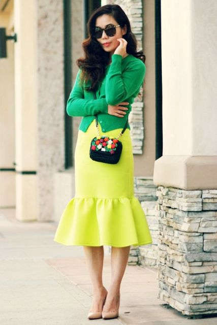 Colorful look with yellow trumpet skirt and green shirt