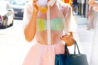 Eye-catching look with colorful bra and sheer shirt