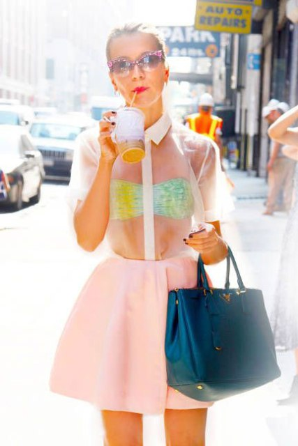 Eye catching look with colorful bra and sheer shirt
