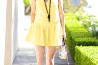 Eye-catching yellow drop waist dress