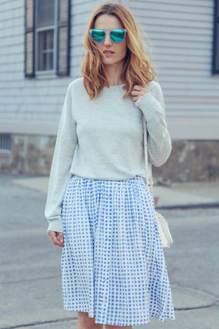 Gentle look with checked skirt and pastel color sweatshirt