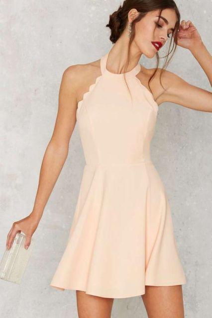 Gentle pink halter dress with scallop hem